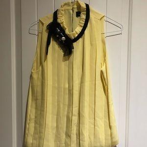 Robert Rodriguez yellow blouse